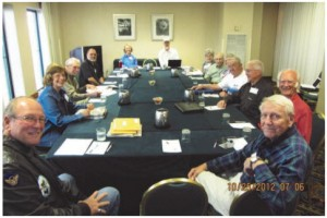 ) The 306th Board takes a break from a busy agenda session:  Steve Snyder, Nancy Huebotter, Walt Rozett, Joel LaBo, Barbara Neal, Charles Neal,  Em Christianson, Bill Houlihan, Judy Hermley, Rocky Rockwell, Walter Lubojacky,  Ralph Franklin, Allan Lawson. Board members not pictured: Cliff Deets and Vernon  Williams.