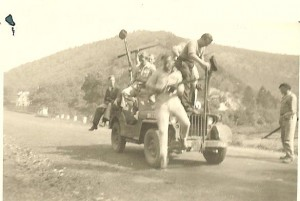 Howard Snyder jumping out of a jeep while fighting with the Maquis in 1944